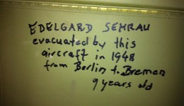 The walls are etched with memories and signatures of Vietnam War Vets who have flown in the aircraft